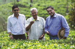 Dilhan C Fernando (right), next generation chief executive of Dilmah, with founding father Merrill J Fernando and elder brother Malik J Fernando in one of the Dilmah tea gardens